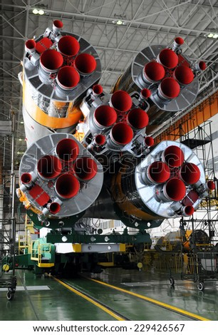 BAIKONUR, KAZAKHSTAN - DECEMBER 16, 2011: The Soyuz rocket and Soyuz TMA-03M spacecraft in the Integration facility building - stock photo