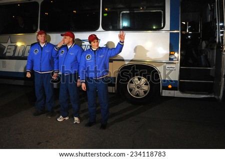 BAIKONUR, KAZAKHSTAN - NOVEMBER 23, 2014: ISS Expedition 42/43 crewmembers T.Virts (left), A.Shkaplerov (center), S.Cristoforetti (right) before departure to the cosmodrome - stock photo