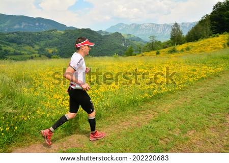 BAILE HERCULANE - JUNE, 8: Trail runner at the Hercules Maraton, fifth edition, in Cernei Mountains, Romania, June 8th, 2014 - stock photo