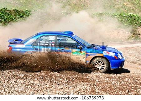 BAKAL, RUSSIA - AUGUST 8: Dmitry Tagirov's Subaru Impreza WRX (No. 9) competes at the annual Rally Southern Ural on August 8, 2008 in Bakal, Satka district, Chelyabinsk region, Russia. - stock photo