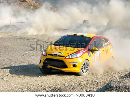 BAKAL, RUSSIA - AUGUST 13: Ivan Vorobyov's Ford Fiesta (No. 15) competes at the annual Rally Southern Ural on August 13, 2010 in Bakal, Satka district, Chelyabinsk region, Russia. - stock photo