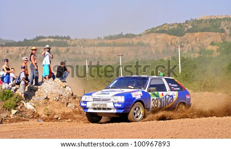 BAKAL, RUSSIA - AUGUST 4: Ivan Vorobyov's LADA Samara (No. 39) competes at the annual Rally Southern Ural on August 4, 2007 in Bakal, Satka district, Chelyabinsk region, Russia. - stock photo