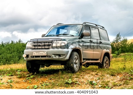 BAKAL, RUSSIA - AUGUST 8, 2008: Motor car UAZ Patriot at the countryside. - stock photo