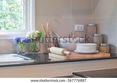 Bake ware set on the black granite top in modern kitchen - stock photo