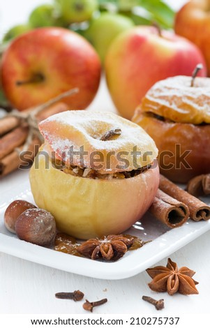 baked apples stuffed with dried fruit, nuts and cottage cheese, vertical, close-up - stock photo