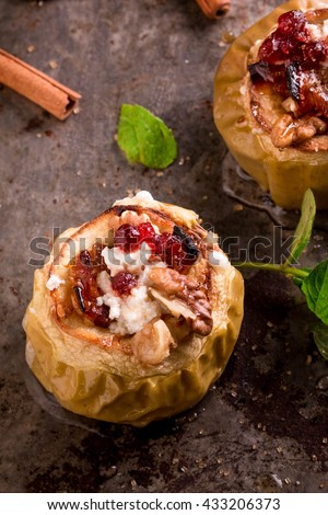 Baked Apples stuffed with gooey caramel and topped with a brown sugar, oat crumble and Goat Cheese. Dessert Recipe - stock photo