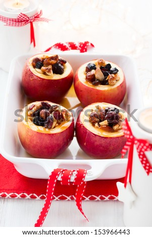 Baked apples stuffed with nuts and dried fruits - stock photo