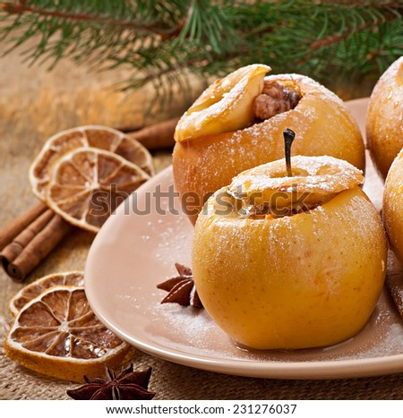 Baked apples with honey and nuts - stock photo
