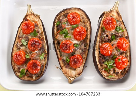 baked aubergines stuffed with cheese , meat and vegetables - stock photo