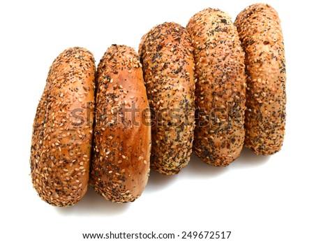 baked bagels on white background - stock photo