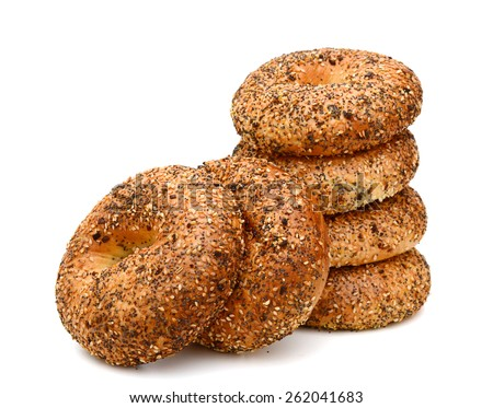 baked bagels with sesame seeds on white background  - stock photo