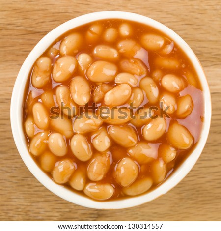 Baked Beans - Bowl of baked beans in tomato sauce. Shot from above. - stock photo