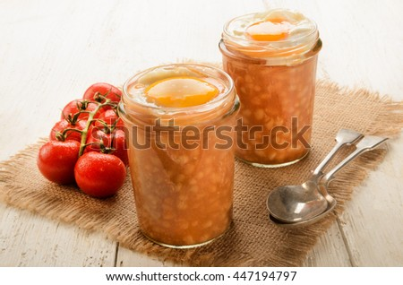 baked beans, fried egg in a glass served with spoon - stock photo