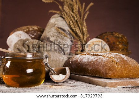 Baked bread on wood table - stock photo