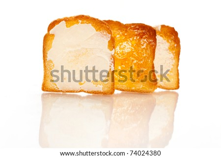 Baked bread with butter - stock photo