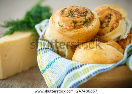 baked buns stuffed with cheese and herbs - stock photo