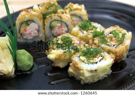 Baked California sushi roll with wasabi and pickled ginger - stock photo