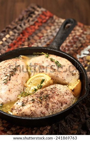 Baked chicken breasts with lemon and garlic - stock photo