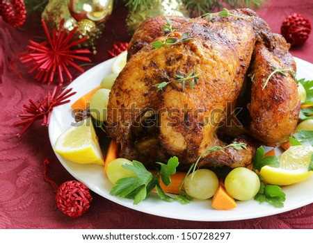 baked chicken for Christmas dinner, festive table setting - stock photo
