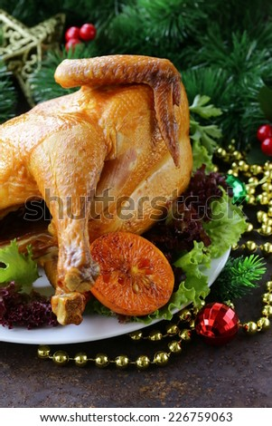 baked chicken for festive dinner, Christmas table setting - stock photo