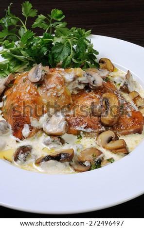baked chicken in a creamy milk gravy with mushrooms - stock photo