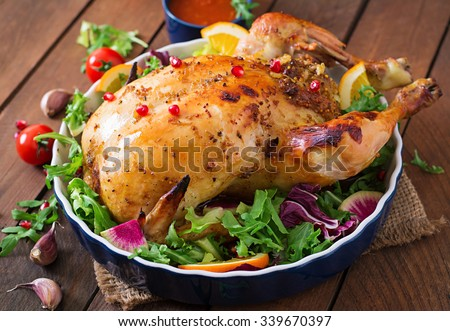 Baked chicken stuffed with rice for Christmas dinner on a festive table - stock photo