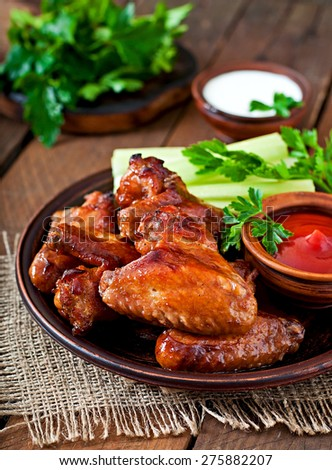 Baked chicken wings with teriyaki sauce - stock photo