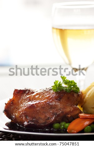 Baked chicken with mashed potatoes, peas and carrots - stock photo