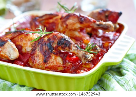Baked chicken with vegetables - stock photo