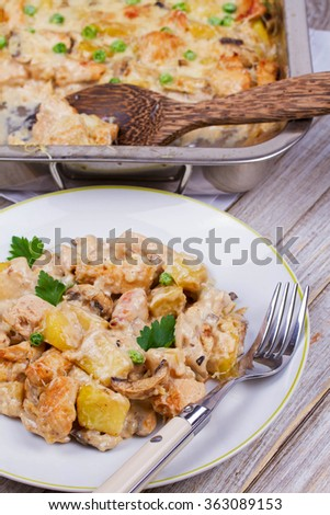 Baked Creamy Chicken, Potato  and Mushrooms - stock photo