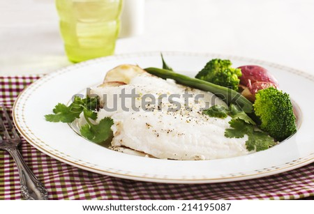 Baked fish fillet served with broccoli, green bean and potato - stock photo