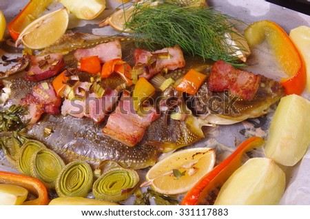 baked fish flounder with vegetable and bacon - stock photo