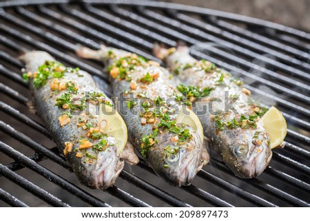 Baked fish with lemon and spices - stock photo