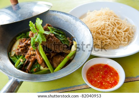baked goose with green beans ,potato,red pepper , green herbs, chinese noodle and sauce - stock photo