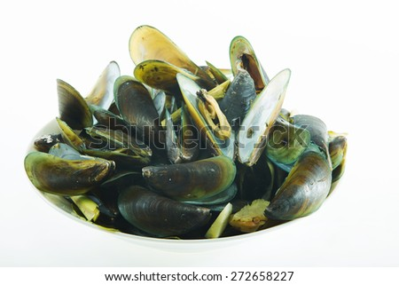 Baked green mussels in plate isolated on white background - stock photo