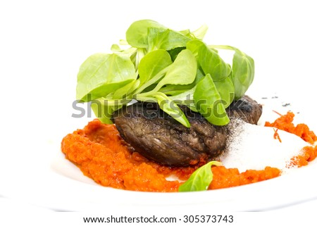 baked meat in a sauce of peppers and tomatoes - stock photo