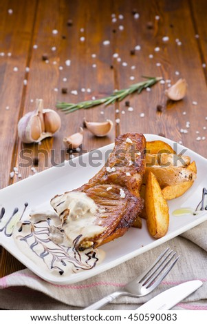 baked meat with potatoes in sauce - stock photo