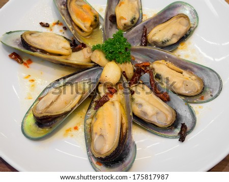 Baked mussels garlic - stock photo