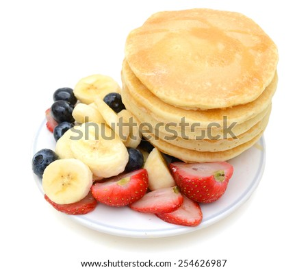 baked pancakes with fresh fruits on plate - stock photo