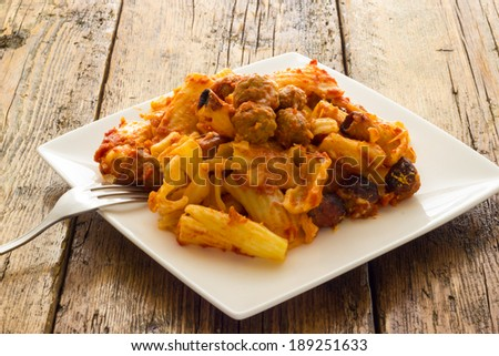 Baked pasta with meatballs - stock photo