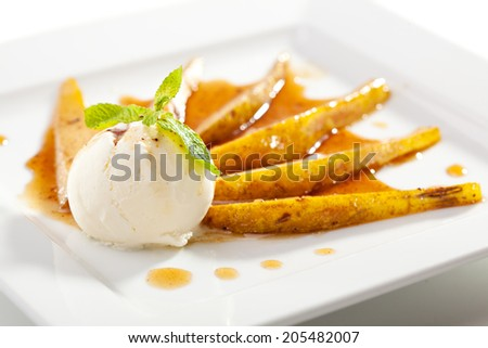 Baked Pear with Ice Cream - stock photo