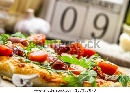 Baked pizza with ham - stock photo