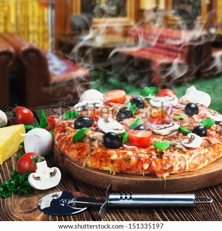 baked pizza with mushrooms and cheese - stock photo