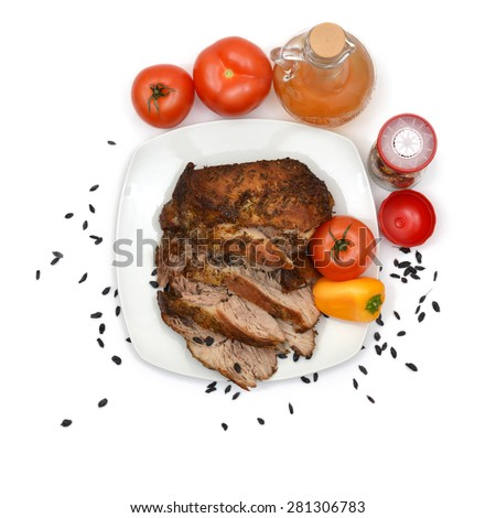 Baked pork on plate with tomatoes and peppers. Top view. - stock photo