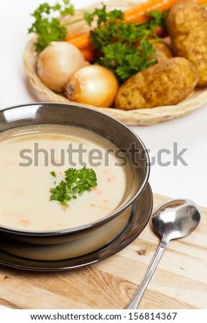 Baked potato cream soup with carrot - stock photo