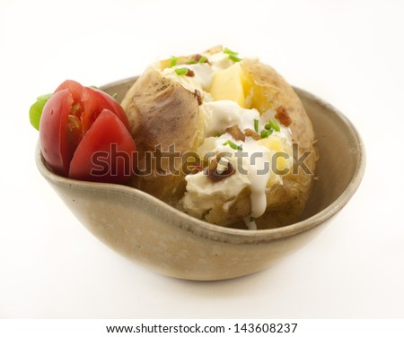 Baked potato in a bowl. Side dishes. - stock photo