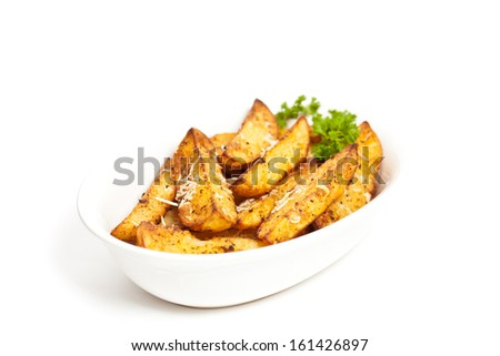 Baked Potato Wedges With Parmesan - stock photo