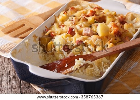 Baked potato with bacon and cheese close up in baking dish. horizontal - stock photo