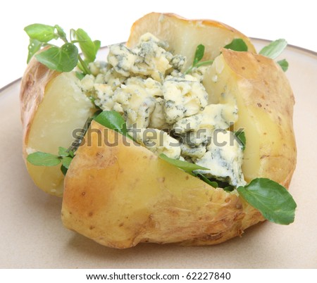 Baked potato with blue cheese and watercress. - stock photo