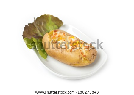 Baked potato with ham and grated cheeses  - stock photo